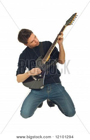 Man Playing Guitar In Knees