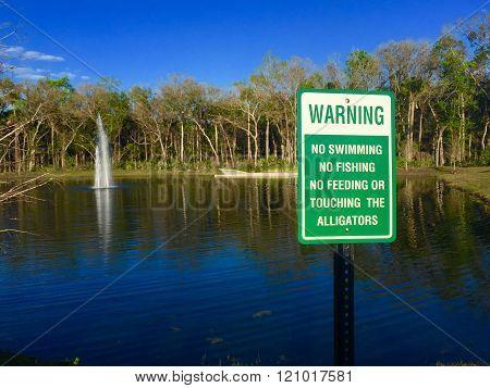 Alligator Warning Sign On Retention Pond