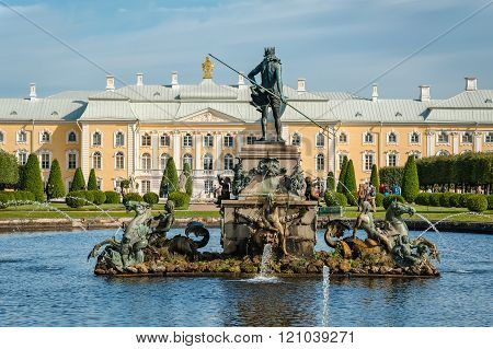 Neptune Fountain And Grand Petergof Palace On Background In St Petersburg District, Russia