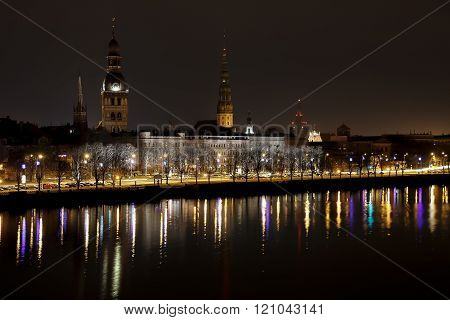 Riga Old Town Panorama At Dusk Over Daugava River