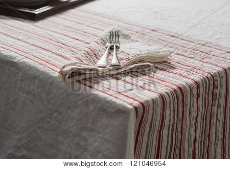 Forks On Napkin And Tablecloth With Red And Brown Barcode Stripes