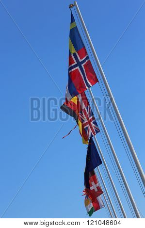 Flags Of Many Nations World Waving In The Blue Sky