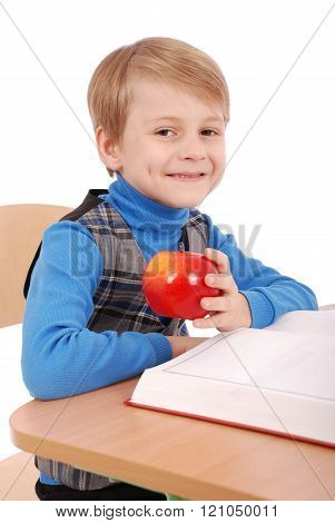 Boy Sitting At A School Desk