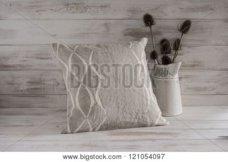 Gray Square Throw Pillow Beside Thistle Plants In Vase