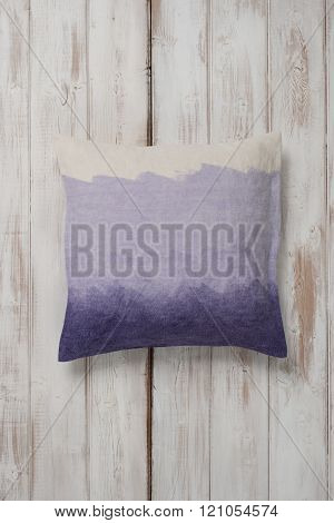 Square Gradient Purple Throw Pillow Laid Flat On Wooden Surface