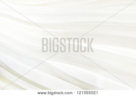 Detail of white pleated skirt. White cloth background pleated