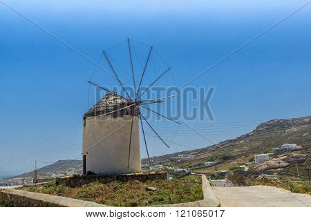 White windmill in Town of Ano Mera, island of Mykonos, Greece