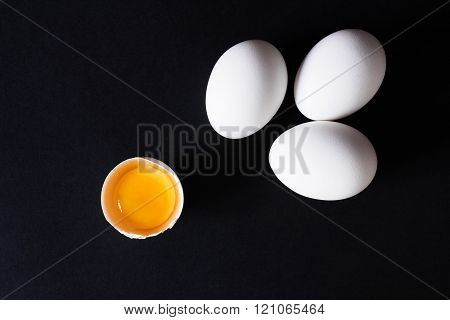 Several eggs on a black background