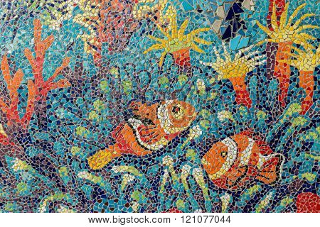 Colorful Glass Mosaic Art Shape Fish And Abstract Wall Background.