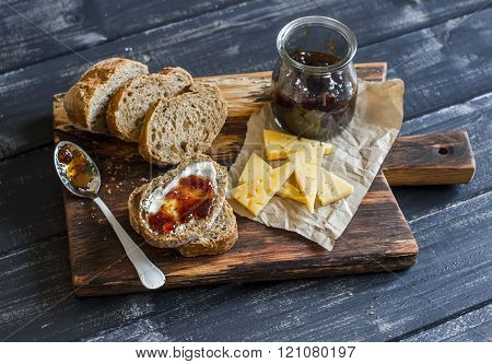 Homemade Whole Grain Bread, Cheese And Figs Jam.  Delicious Breakfast Or Snack. On A Wooden Rustic B