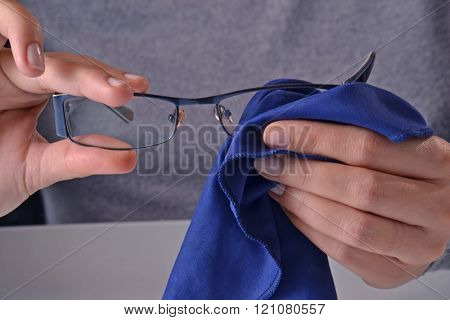 Cleaning eye glasses.