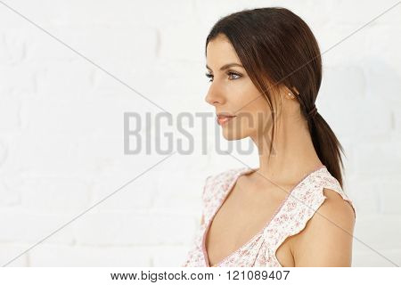 Profile of attractive young woman.