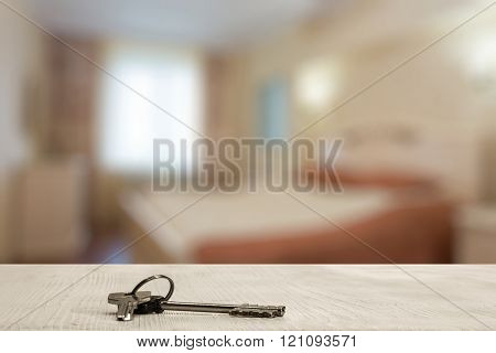keys on white wooden table in the bedroom