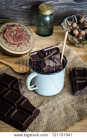 chocolate in a cup on wooden table