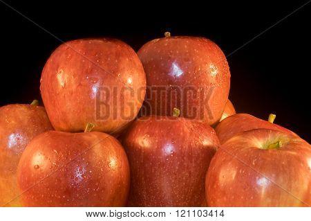 Fresh apples on black background.