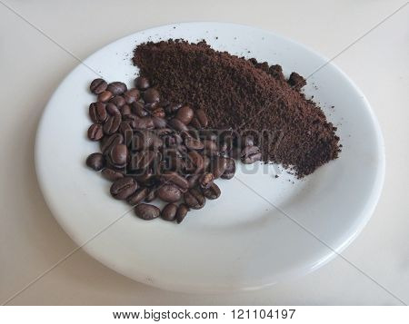 Milled Coffee On A White Plate
