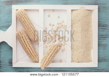 White corn on the cob and corn flour