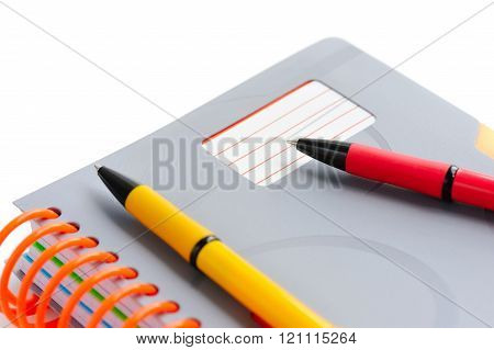 Notebook And Pens Isolated On White Background