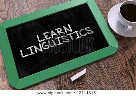 Learn Linguistics Handwritten on Chalkboard.
