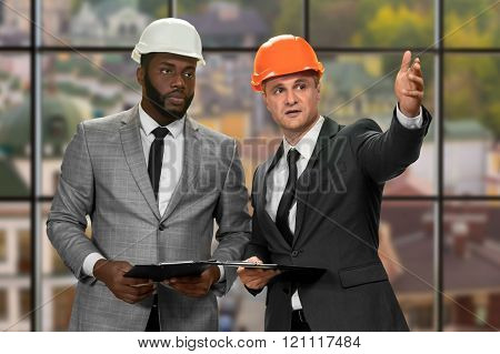 Two construction managers' daytime meeting.