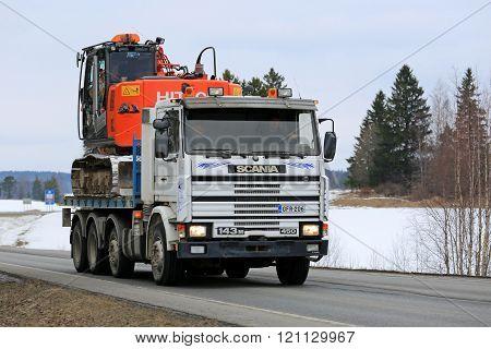 Scania 143M Truck Hauls Excavator