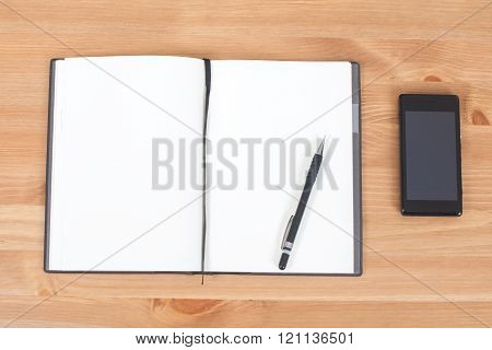 Opened Notebook Or Notepad With Pen And Ink On Wooden Desk