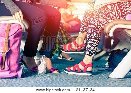 Airport Passenger Waiting Plane At Bangkok Departures Gate - Women Crop Legs With Travel Bags