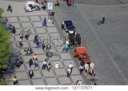 Prague, Czech Republic - April 24, 2013:  People Walking And Horse Carriages Waiting For Tourists At