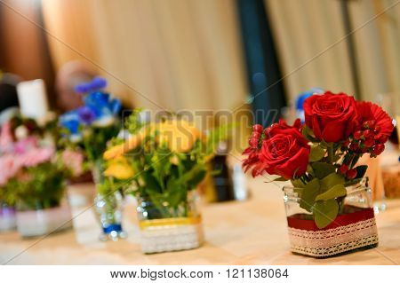 Bouquet Of Roses Sitting On A Wedding Table