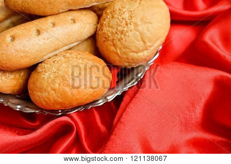 Bread Placed In A Metal Basket On A Red Velvet Surface
