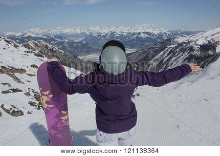 Young Woman On The Kaprun, Skiing Resort In Austria. A View From The Back.
