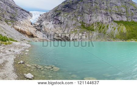 Briksdalsbreen - Briksdal glacier, Briksdalsbreen glacier, Stryn in Sogn, Norway.  Briksdalsbreen - Briksdal glacier,  is one of the most accessible and best known arms of the Jostedalsbreen glacier.