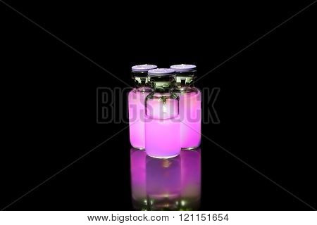 Vials With Purple Medicine