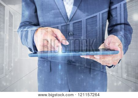 Close up view of businessman using tablet computer against grey background