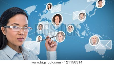 Attractive businesswoman holding pen against map with emails