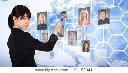 Focused businesswoman pointing against background with europa map
