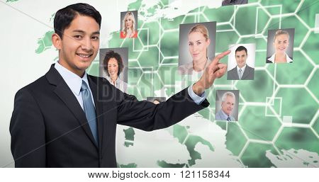 Smiling asian businessman pointing against background with hexagons and europa map