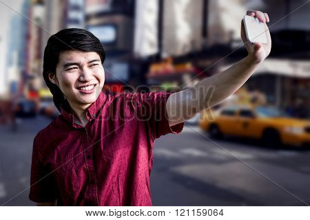 Hipster man taking a selfie against blurry new york street