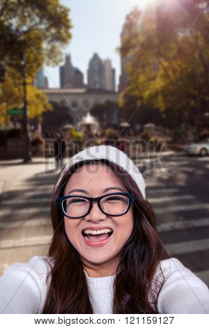 Asian woman smiling at the camera against new york street
