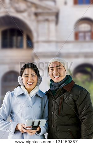 Cheerful couple against buildings against historic building