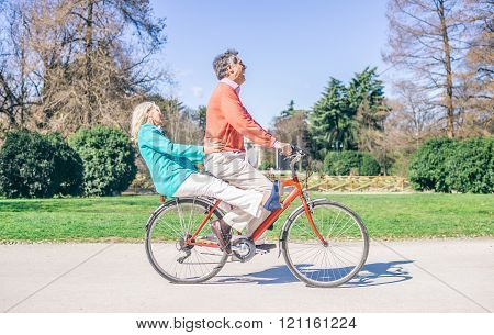 Senior Couple Riding Bike