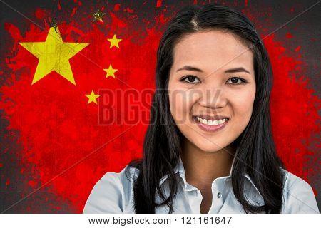 Smiling woman looking at camera against china