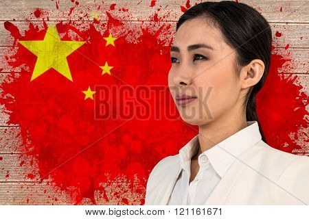 Smiling woman looking away against china