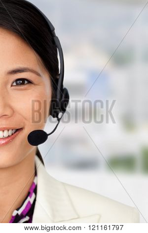 Radiant businesswoman using binoculars against office