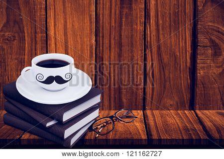 Mustache logo against overhead of wooden planks