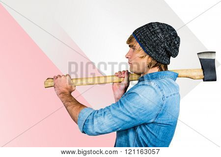 Side view of hipster standing with axe against rosa beige and white