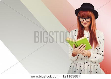 Hipster woman reading a green book against colored background