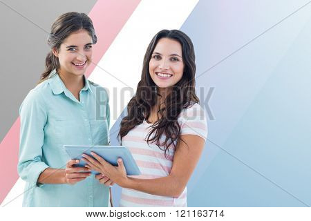Smiling businesswoman with tablet against colored background