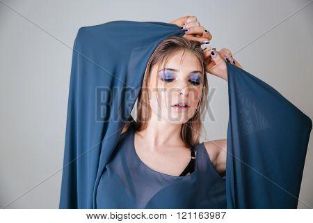 Beautiful female model posing over gray background