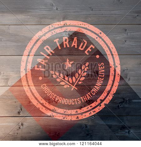 Fair Trade graphic against colored wood